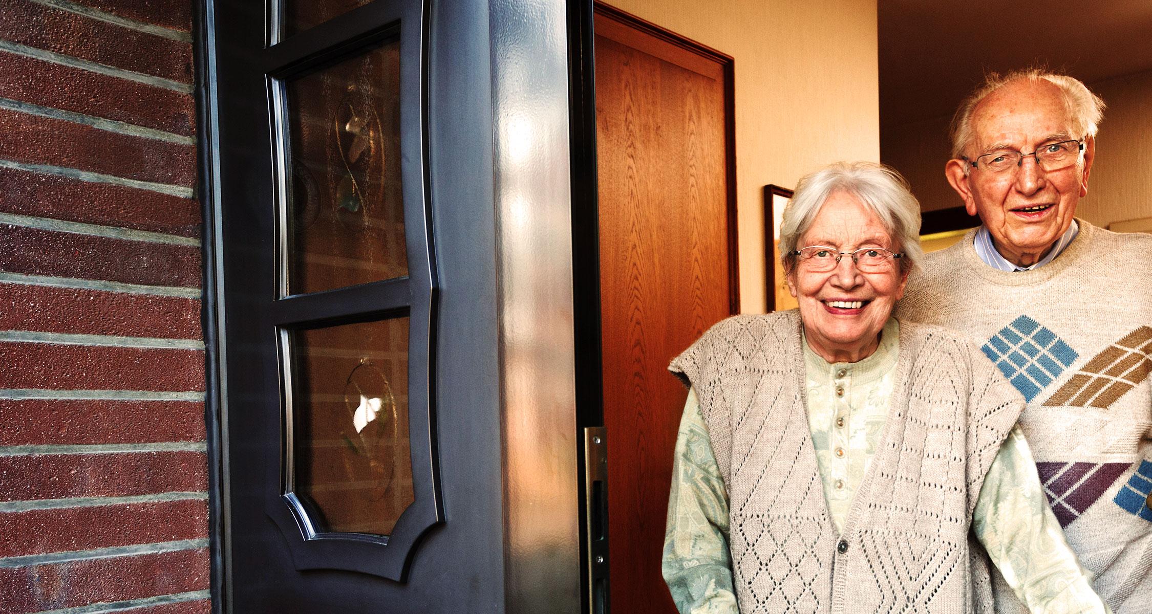 elderly couple in doorway